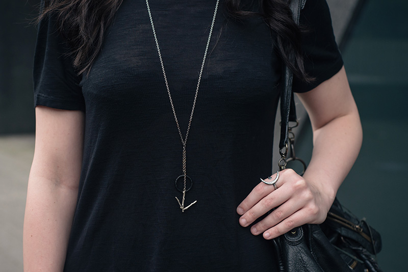 Fashion blogger Stephanie of FAIIINT wearing H&M asymmetric tee shirt, Hvnter Gatherer Lacustrine necklace, Wolf + Sadie Theurgy silver ring, Balenciaga city bag. All black everything outfit details.