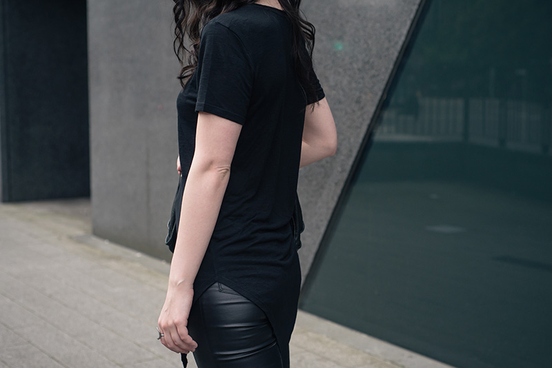 Fashion blogger Stephanie of FAIIINT wearing H&M asymmetric tee shirt, New Look coated jeans. All black everything casual goth dark street style outfit..