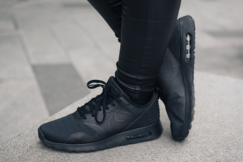 FAIIINT wearing Nike Air Max Tavas triple black trainers. All black everything casual details.
