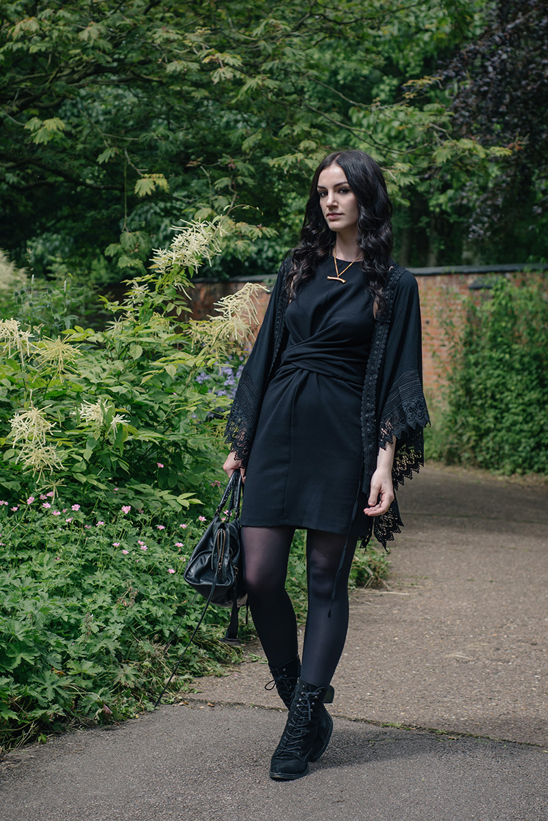 Fashion blogger Stephanie of FAIIINT wearing Blue Vanilla New Look Lace trim draped kimono, ASOS wrap knot dress, Sara Gunn gold bone necklace, Kurt Geiger Saturn boots, Balenciaga city bag. All black everything dark gothic witchy style outfit.
