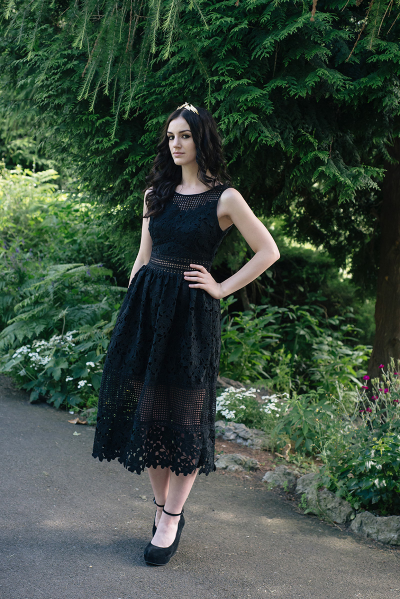 Fashion blogger Stephanie of FAIIINT wearing ASOS gold leaf crown headband, Miss Selfridge mixed lace dress, Aldo suede wedges. All black everything gothic wedding guest outfit, dark street style.