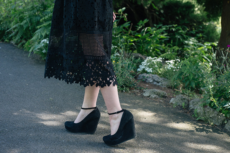 Fashion blogger Stephanie of FAIIINT wearing Miss Selfridge mixed lace dress, Aldo suede wedges. All black outfit details.