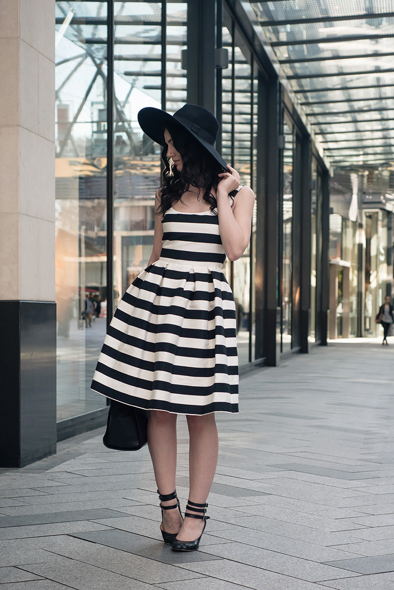 Fashion blogger Stephanie of FAIIINT wearing Warehouse black and white bold striped dress, H&M wide brim fedora, Vivienne Westwood animal toe mary jane shoes. Summer goth vintage street style outfit.