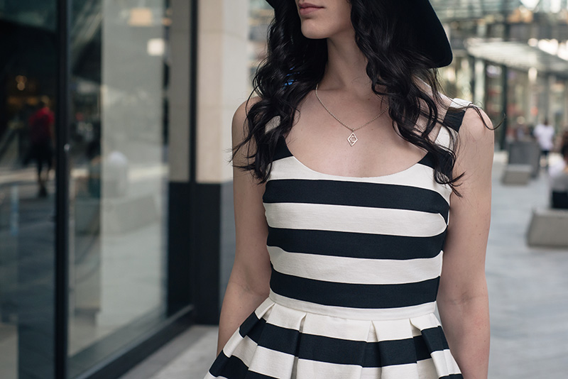 Fashion blogger Stephanie of FAIIINT wearing Warehouse black and white bold striped 50s prom dress, Bloody Mary Metal tribal moon silver necklace. Outfit details.