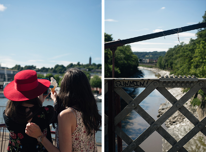 Bristol bridge landscape. Girls taking instagram photo of ice cream.
