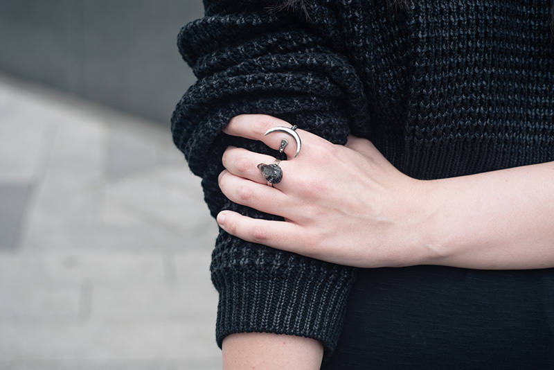 Fashion blogger Stephanie of FAIIINT wearing The Ragged Priest cropped chunky knit coated jumper, Wolf + Sadie Theurgy crecent silver ring, Elemental Luxury tibetan phantom quartz ring. All black everything dark style outfit details.