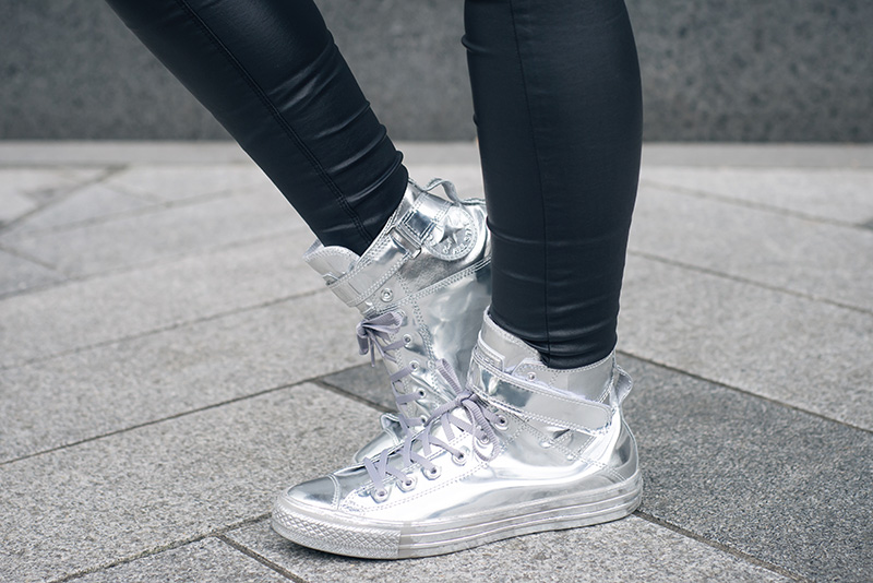 Fashion blogger Stephanie of FAIIINT wearing Converse Chuck Taylor All Star Brea chrome silver high top sneakers. Street style outfit details.