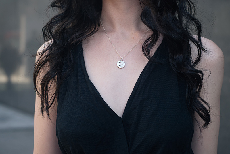 Fashion blogger Stephanie of FAIIINT wearing Ailsigr crescent moon and stars silver necklace. Outfit details.