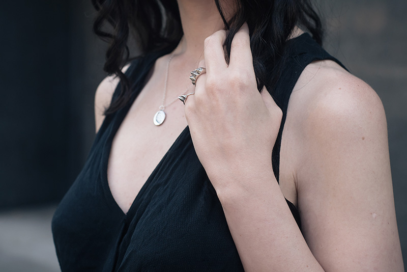 Fashion blogger Stephanie of FAIIINT wearing Ailsigr silver statement mountain rings and cresecent moon and stars necklace. Outfit details.