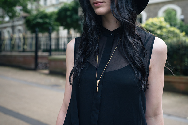 Fashion blogger Stephanie of FAIIINT wearing Ailsigr gold symbols talisman pendant necklace. Outfit details.