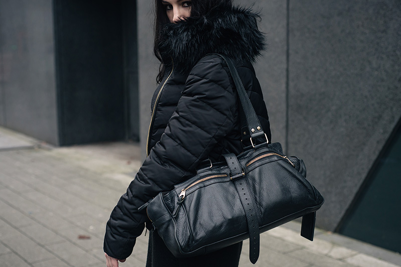 Fashion blogger Stephanie of FAIIINT wearing H&M quilted padded down jacket with faux fur collar, Mulberry Mabel bag. All black winter street style outfit details.