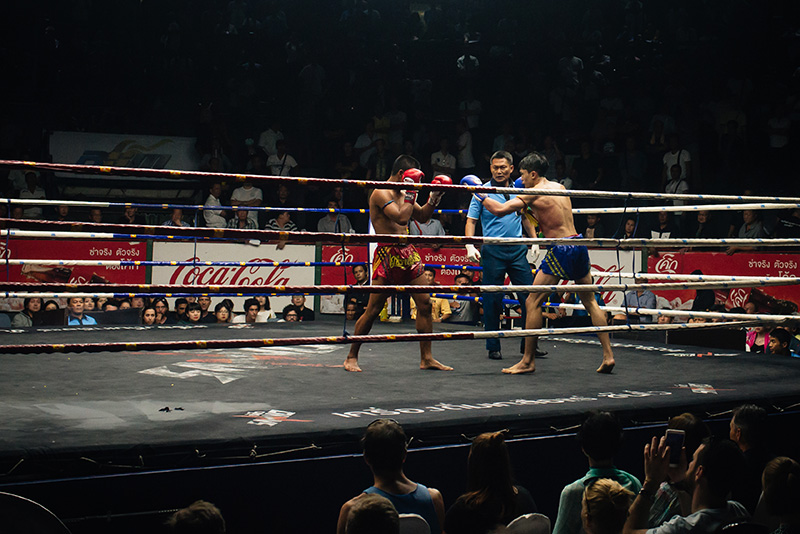 Bangkok Thailand Muay Thai fight in the ring at Rajadamnern Stadium.