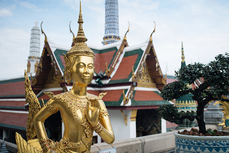 Temples of Bangkok Thailand, The Grand Palace and Wat Phra Kaew, gold kannari kinnon statue.