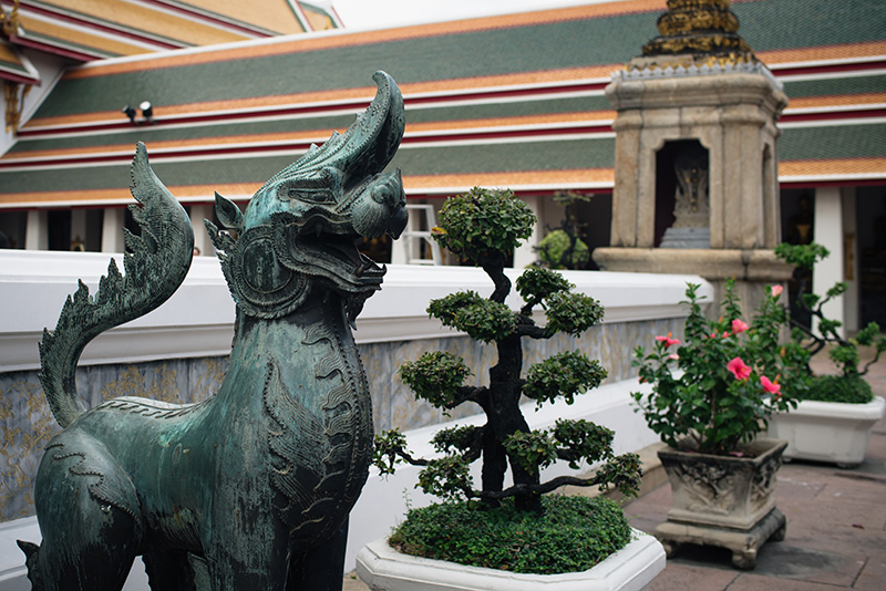 Temples of Bangkok Thailand, Wat Pho bronze lion statue.