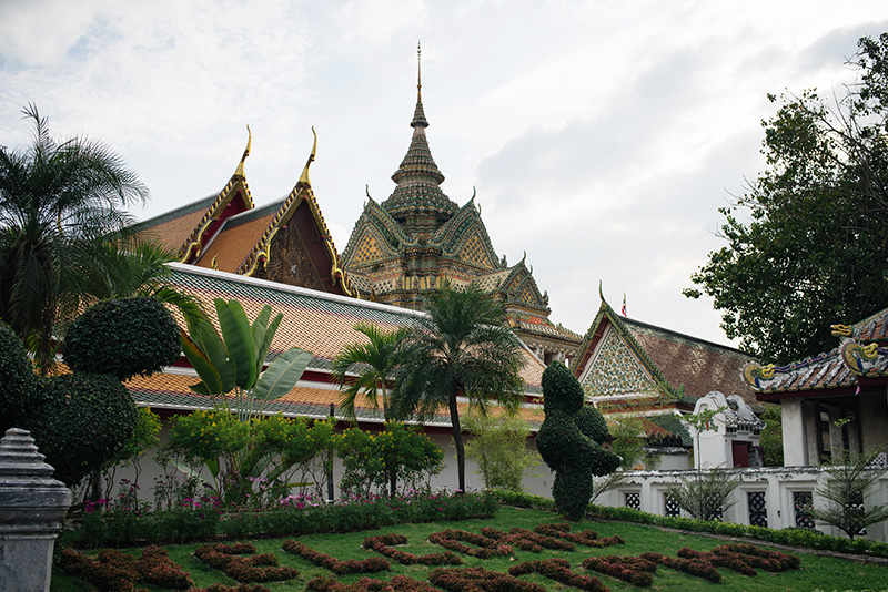 Temples of Bangkok Thailand, Wat Pho garden with temple.