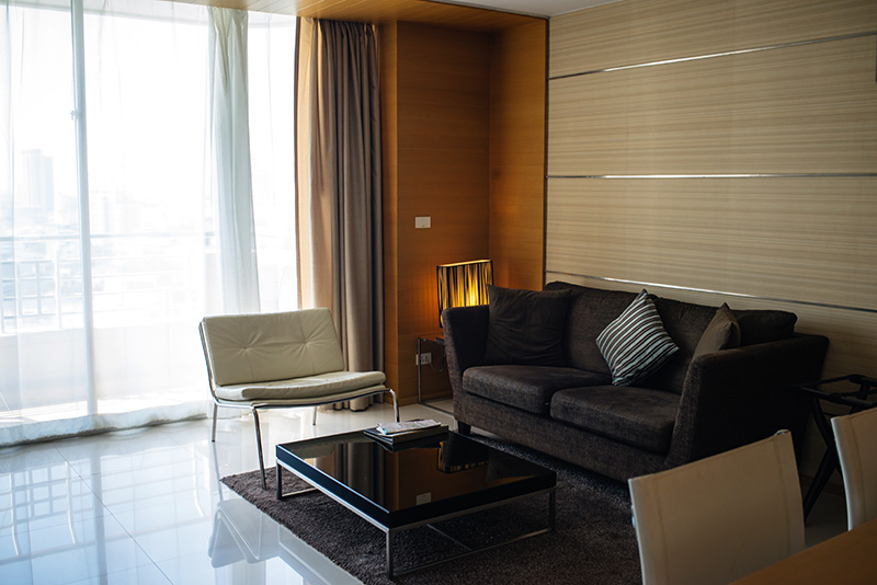 Anantara Sathorn Bangkok hotel Thailand room lounge area one bedroom suite.