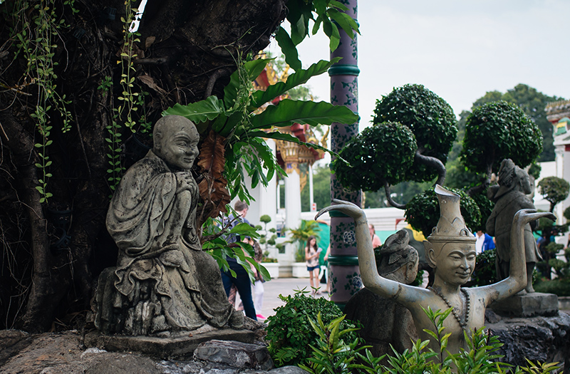 Temples of Bangkok Thailand, Wat Pho garden with statues.