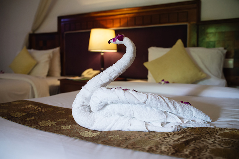 Sokhalay Angkor Villa Resort in Siem Reap Cambodia, room and bed with towel swan.