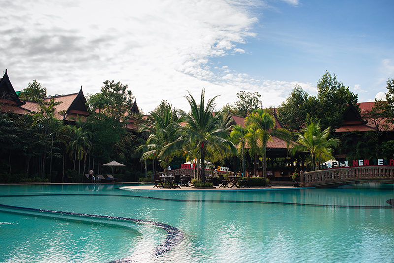 Sokhalay Angkor Villa Resort in Siem Reap Cambodia, tropical pool area with palm trees.