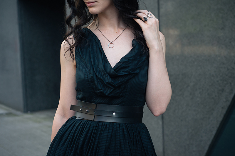 Fashion blogger Stephanie of FAIIINT wearing All Saints dress, Pieces wide leather waist belt, Wolf + Sadie Lucid Petite silver necklace and Theurgy claw ring, Elemental Luxury raw phantom quartz ring. All black outfit details.