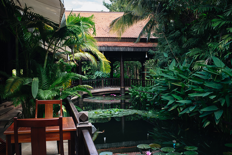 Sokhalay Angkor Villa Resort in Siem Reap Cambodia, dining area next to pond water with lily pads.