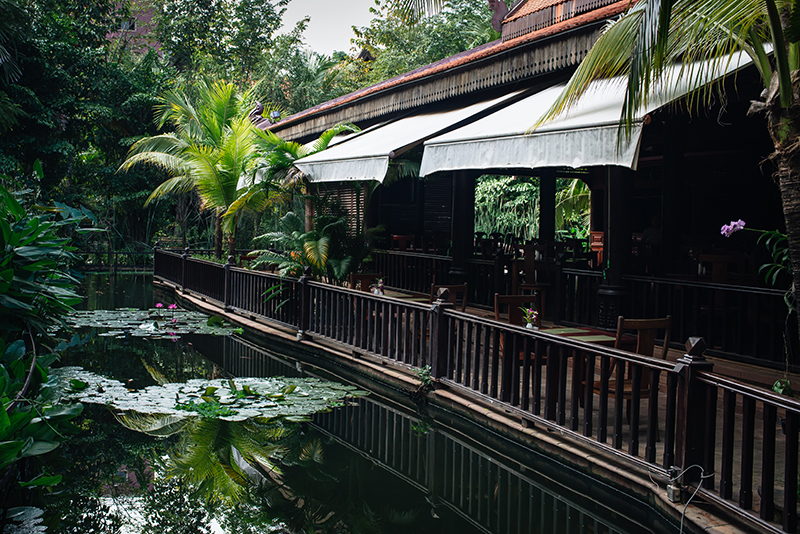 Sokhalay Angkor Villa Resort in Siem Reap Cambodia, dining area next to pond with lily pads.