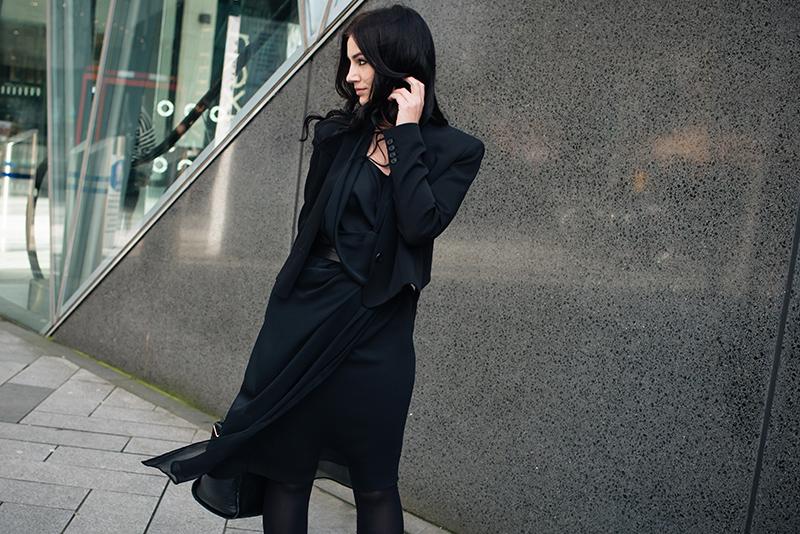 Fashion blogger Stephanie of FAIIINT wearing Theyskens' Theory cropped tailored jacket, River Island draped chiffon dress. All black everything dark street style outfit.