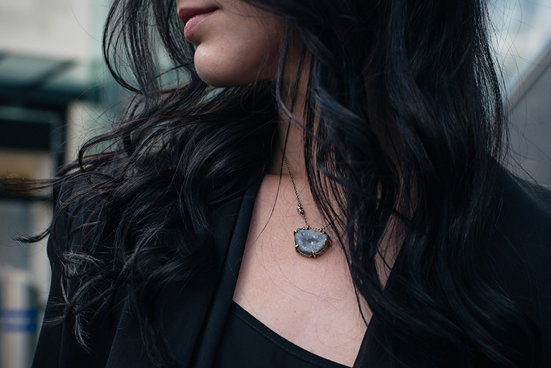 Fashion blogger Stephanie of FAIIINT wearing The Silver Cafe Blue Topaz druzy crystal necklace. Dark style outfit details.