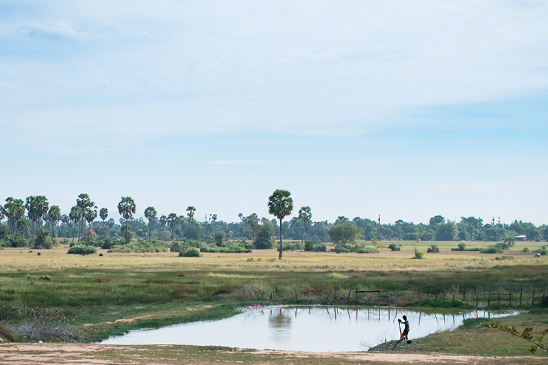 Motorbiking through the Siem Reap countryside in Cambodia lake and landscape.