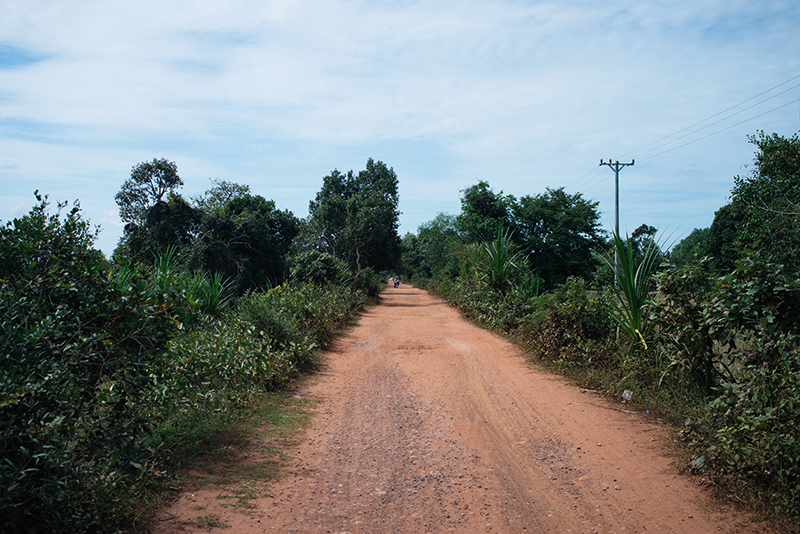 Countryside landscape in Siem Reap Cambodia, dusty red orange roads..