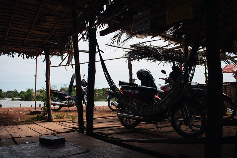 Motorbiking through the Siem Reap countryside in Cambodia on a Honda Dream with Khmer Ways, roadside stop.