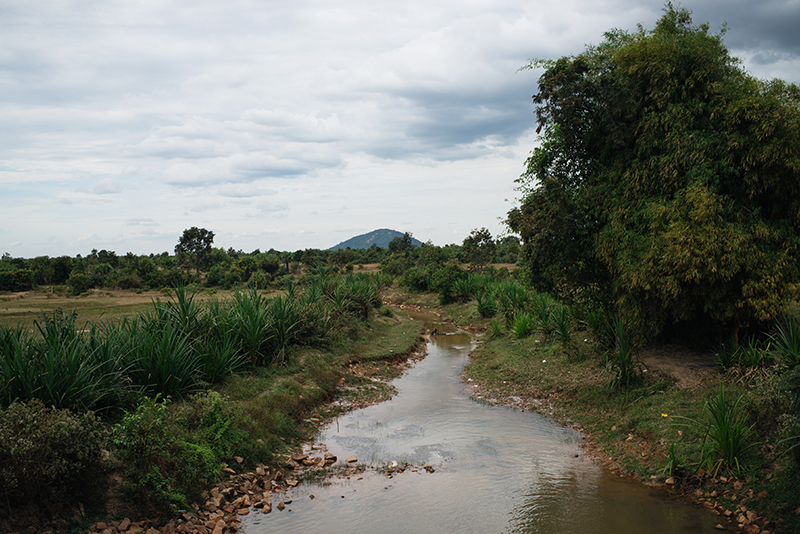 Countryside landscape in Siem Reap Cambodia, stream and views of Phnom Kulen mountain.