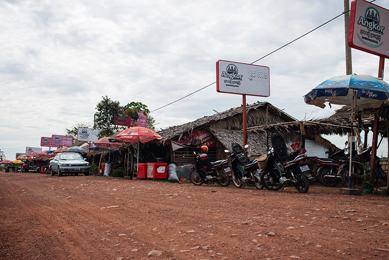 Motorbiking throught the Siem Reap countryside in Cambodia on a Honda Dream, roadside stop.