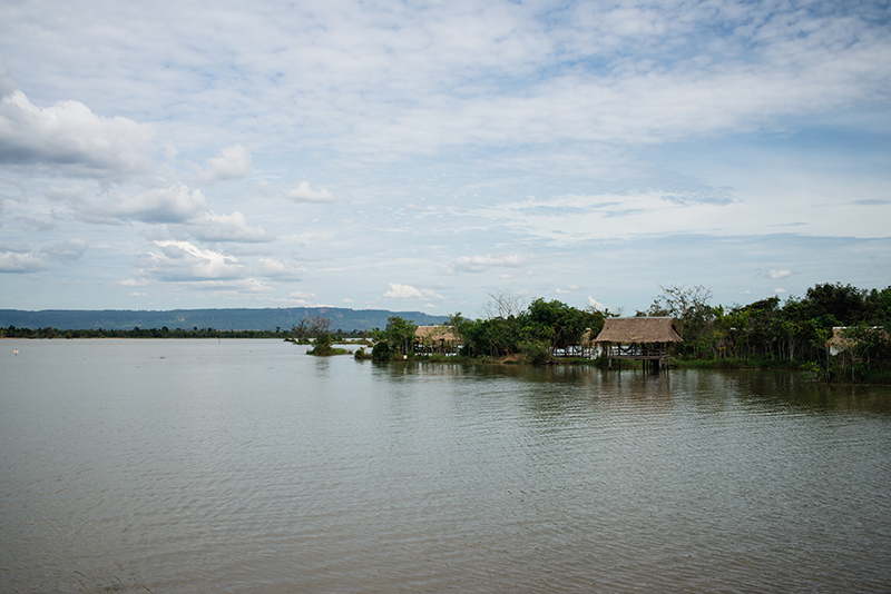 Countryside landscape in Siem Reap Cambodia, reservoir with wooden shelters.
