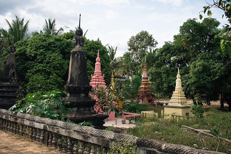 Siem Reap Cambodia Buddhist temple small stupas in the garden.