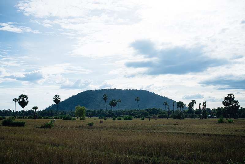 Countryside landscape in Siem Reap Cambodia, field and Phnom Kulen mountain.