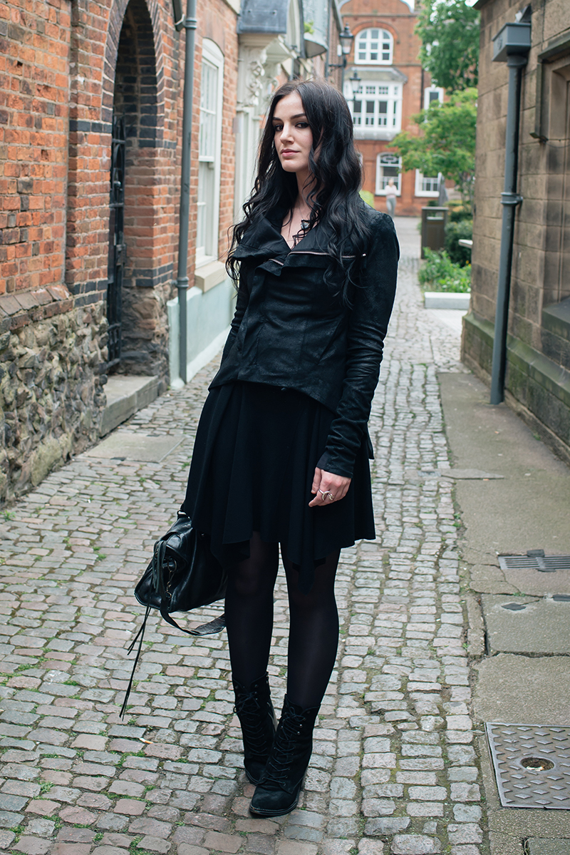 Dark style fashion blogger Stephanie of FAIIINT wearing Rick Owens Naska blistered lamb leather jacket, Helmut Lang drape skirt, Kurt Geiger saturn boots, Balenciaga city bag. All black street style outfit.