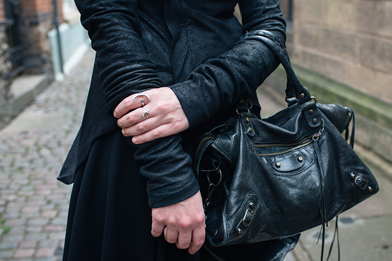 Dark style fashion blogger Stephanie of FAIIINT wearing Rick Owens Naska blistered lamb leather jacket, Balenciaga city bag, Le Lou Ula & Birds N Bones silver claw rings. All black street style outfit details.
