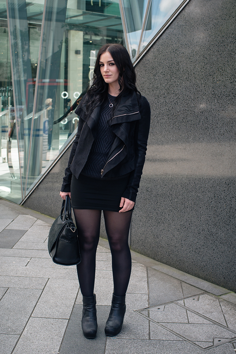 Dark style fashion blogger Stephanie of FAIIINT wearing Arura cable knit t-shirt jumper, H&M skirt, Rick Owens twill drape jacket, Rick Owens wedge boots. All black street style outfit.