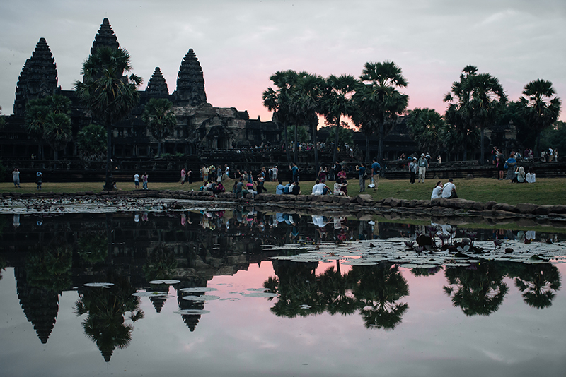 Pink purple sunrise at Angkor Wat temple complex Siem Reap Cambodia.