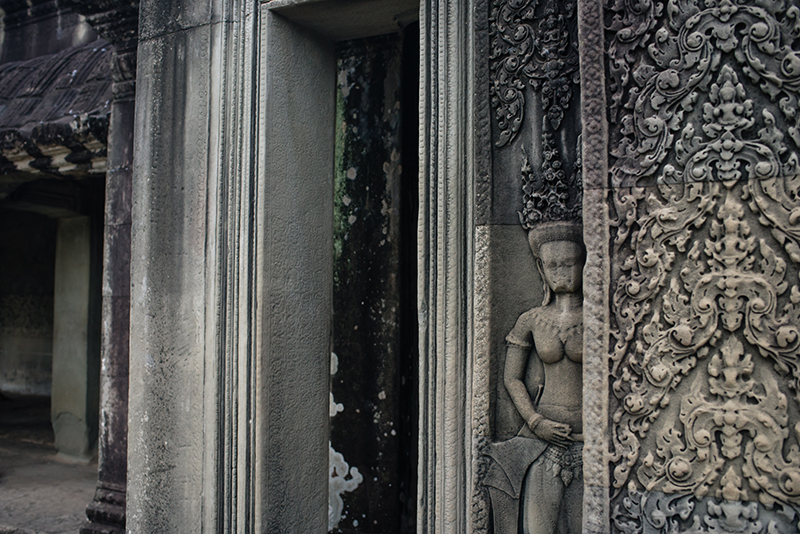 Detail of carvings at Angkor Wat temple complex Siem Reap Cambodia.