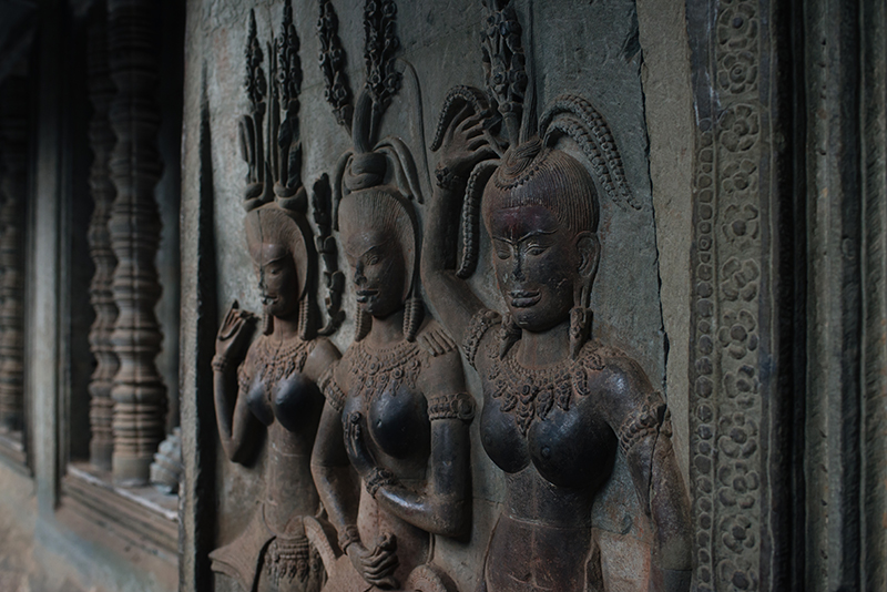 Details of carvings female dancers at Angkor Wat temple complex Siem Reap Cambodia.