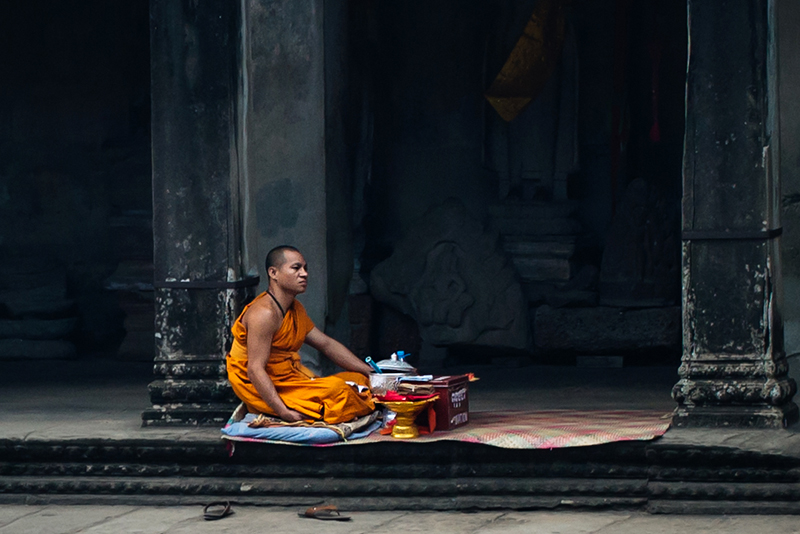 Monk at Angkor Wat temple complex Siem Reap Cambodia.