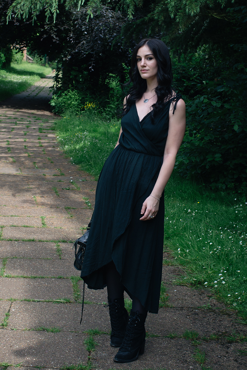 Fashion blogger Stephanie of FAIIINT wearing cotton wrap dress, Toilworn silver jewellery and Kurt Geiger Saturn lace up boots. All black dark fashion street style outfit.