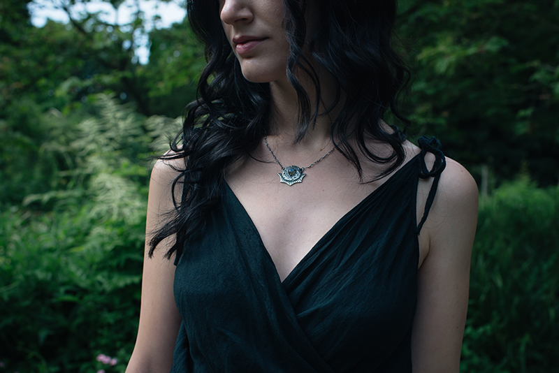 Fashion blogger Stephanie of FAIIINT wearing cotton wrap dress, Toilworn silver luna landing labradorite moon necklace. All black dark style outfit details.