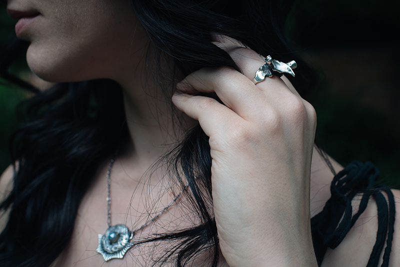 Fashion blogger Stephanie of FAIIINT wearing Toilworn silver vertebra ring and labradorite moon necklace. All black dark style outfit details.