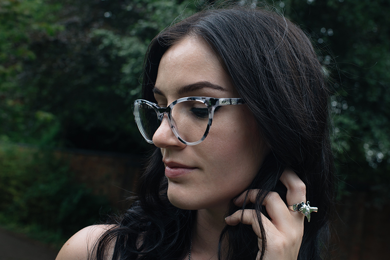 Fashion blogger Stephanie of FAIIINT wearing IOLLA Muir smoke tortoise cat eye frames glasses, Toilworn vertebra silver ring.