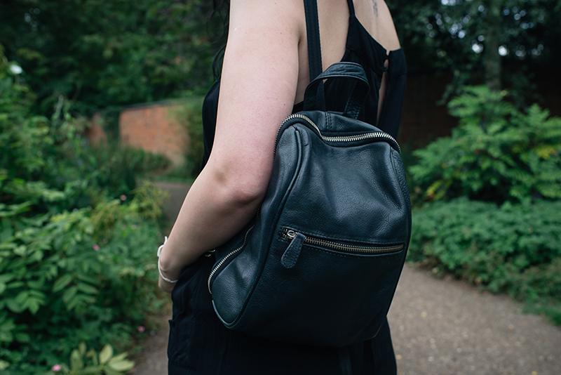 Fashion blogger Stephanie of FAIIINT wearing New Look leather backpack. All black everything outfit details.