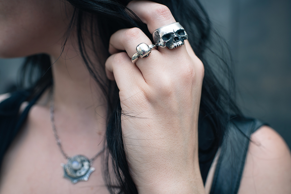 Fashion blogger Stephanie of FAIIINT wearing Toilworn jewellery large silver skull ring, mini skull ring and luna landing moon necklace. Goth outfit details.