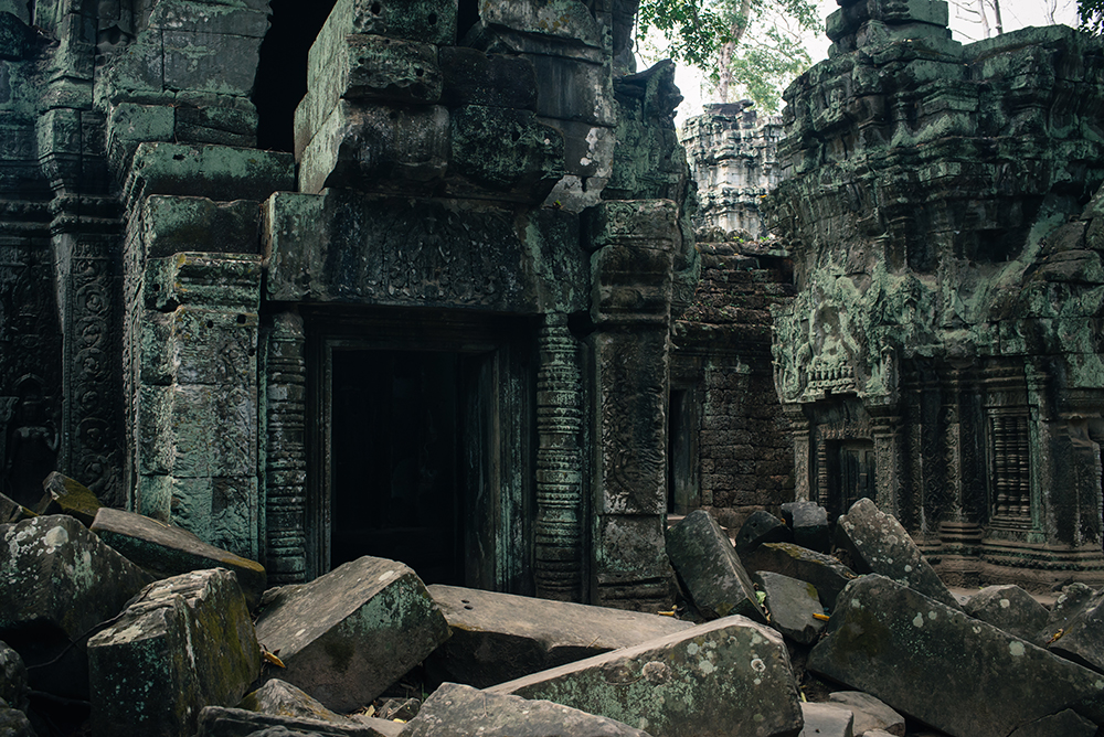 Ta Prohm temple Siem Reap Angkor Cambodia. Crumbling ruins reclaimed by nature and overgrown with trees and plants.